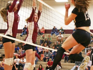 Victoria Phelan went high to spike the ball against Telluride.