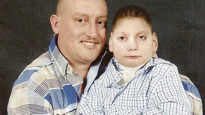 Chris Cady, a petty officer first class in the Navy, pictured with his son Joshua, was named the 2011 military father of the year, selected from among 600 nominations. Cady is a single father and Joshua has special needs. Cady is the son of Rangely's Bill Cady.