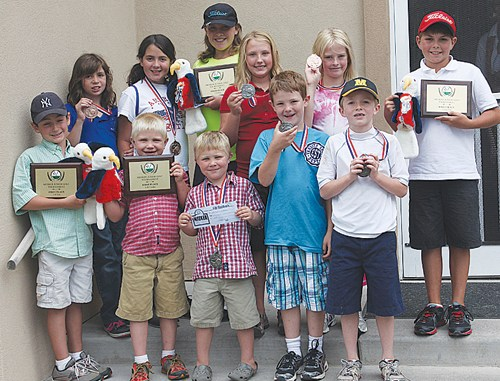 Jim Cook Many of the winners of the Meeker junior golf tournament gathered for a group photo. (Front) Braydan Garcia, Connor and Cade Blunt, Dax Sheridan and Trinenden Powell. (Back) Savana May, Barbara Jex, Macy Smith, Addie Joy, Matilda Brown and Jason Smith.