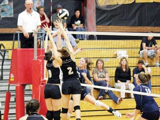 tracy enterline Meeker's Bailey Atwood (9) and Aly Ridings (2) block a shot with teammate Adrienne Wix (7) playing backup. Meeker beat Rangely but lost to Vail Christian last Saturday and will travel to Paonia Friday before hosting Vail Mountain Saturday.  Photo by Tracy Enterline