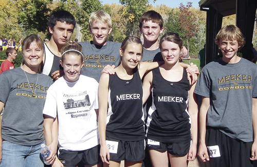 The Meeker High School cross country program, led by first-year coach Sheri Kehr, qualified three runners: senior Krissie Harman, junior Lathrop Hughes and sophomore Jake Boesch for the Colorado Cross Country State Championship meet this season. Pictured with coach Kehr are Krissie Harmon, Lindsey Patterson, Sydney Boes and Bailey Mantle. (Back row) Willis Begaye, Jake Boesch and Lathrop Huges.