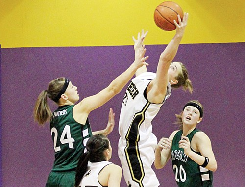 Meeker senior Kathryn Doll pulls in a rebound over Rangely's Quincey Thacker in the first round of the district tournament. Meeker beat Rangely but lost to Paonia in the championship game.