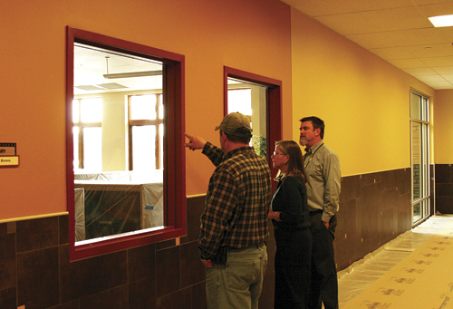 Travis Huppert, the on-site superintendent for The Neenan Company, points out some of the preparations made at the school to Meeker superintendent of schools Susan Goettel and Meeker Elementary School principal Jason Hightower. The Neenan Company started the repair work Wednesday and expect them to be completed by July 2012. A presentation of the completed and approved reconstruction plans for the Meeker Elementary School will be given at the regular school board meeting Tuesday Feb. 7, in the high school cafeteria at 7 p.m.