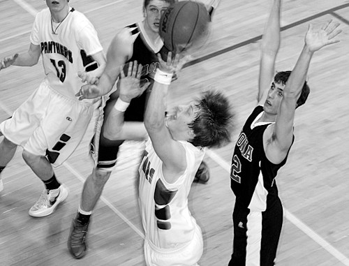 Panther senior Kody Denny goes up for two points in the pigtail game against Paonia, which Rangely lost, ending their season. Denny scored 16 points in his final high school game.