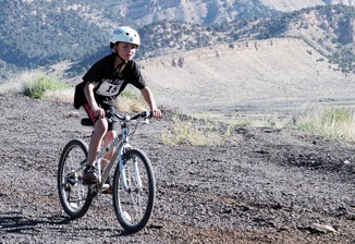 Elijah Deming, pictured on his bike, won the ERBM Kid's Triathlon last week in a competitive field of six young triathletes. Deming completed the two laps in the pool, a two-mile bike ride and one-mile run in 18:34, three seconds ahead of Cole Rogers. Eleven seconds separated the top four placers.