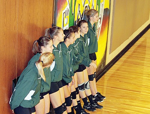 The RHS varsity volleyball team waits to take the court. Rangely will play in Paonia and Hayden this weekend.
