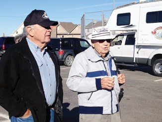 Julius Poole (left) visits with former U.S. Senator Ben Nighthorse Campbell, who is driving the tree to Washington, D.C.
