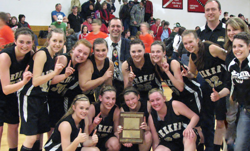 The Meeker girls' basketball team won the District 5 championship last Saturday in Paonia, after defeating the host team  61-58 and will host the Region 5 tournament this weekend at Grand Junction Central High School. Playing on Meeker's first girls' district championship team are (front) Megan Parker, Taylor Neilson, Aly Ridings and Deena Norell, (back) Katie Dinwiddie, Jamie McLaughlin, Sydney Hughes, Bailey Atwood, head coach Greg Chintala, Kacey Collins, Piper Haney,  Amanda Kendall, assistant coaches Mike and Karen Dinwiddie and Kaysyn Chintala.