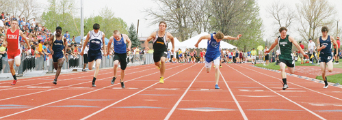While the runners on each side of him lean, Meeker's T.J. Shelton flew across the finish line to win the 100-meter dash Saturday in Denver at the 2013 Colorado State Track and Field Championships held in Jefferson County Stadium. Rangely senior Colton Coombs (second from right), who ran against Shelton all season, finished fourth. Shelton finished second at the state meet in the 200 and anchored the 4x100 relay, which earned a bronze medal.