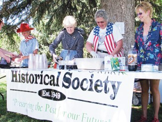 The Rio Blanco County Historical Society serves rootbeer floats after the Bank Robbery re-enactment.