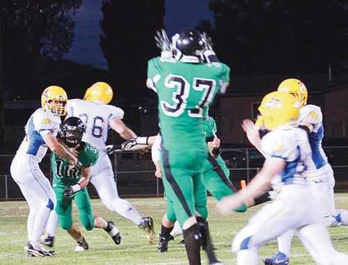 Junior Colt Allred catches a pass from Kelton Elam against Dove Creek.