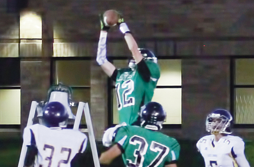 Panther senior Cameron Enterline caught four passes from Kaulan Brady for 91 yards and is pictured intercepting a Mustang pass in the end zone. Enterline was also crowned the homecoming king.