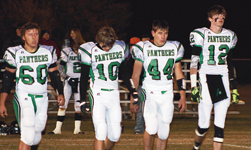 "Rangely seniors Ryan Wilczek (60), Lucas Heinle (10), Wesley Goddard (44) and Cameron Enterline (12) walked to the middle of the football field in Kiowa for the final coin flip of their high school careers. ""My seniors did a terrific job in their leadership roles,"" Fortunato said. ""They showed up every day and worked very hard for me."""