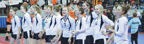 The Meeker High School varsity volleyball team (above), which included freshman Jenna Walsh, seniors Aly Ridings, Taylor Neilson and Piper Haney, juniors Sydney Hughes, Reagan Pearce and Jamie McLaughlin and freshman Maggie Phelan, juniors Paige Jones and Megan Parker and freshman Lori Ann Klinglesmith, lined up twice on one of five courts in the Denver Coliseum for matches in the 2013 Colorado State Volleyball Championships. Meeker qualified as regional champions for the big show, which included championships in all five classifications, and they defeated Ridgeway for a second time in as many weeks, but lost to the eventual 2A state champions Resurrection Christian in pool play. (Below) Meeker head coach Christy Atwood and her senior captains Taylor Nielson, Piper Haney and Aly Ridings listen to court instructions before playing Resurrection Christian, a private school in Loveland.