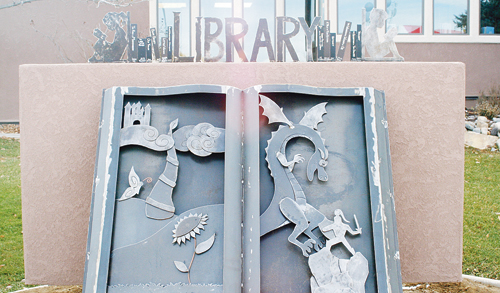Local metal artist Kyle Stewart partnered with his wife, Ashley, to bring the Rangely Library's new sign to life on Main Street. The Stewarts used approximately 30 square feet of metal, with 55 separate pieces cut and welded together to create the 150-pound sculpture.