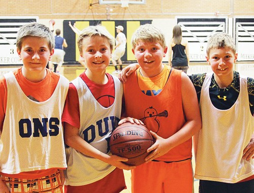 """""""The Four AmiBros,"""" pictured bottom left, included Brennan Ibach, Elijah Deming, Jake Shelton and Cole Rogers."""