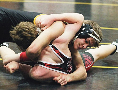 Meeker senior J.C. Henderson wrestled eight matches in the Tournament of Champions, winning five and placing eighth at 138. Henderson is pictured defeating his opponent from Grand Valley 16-2.