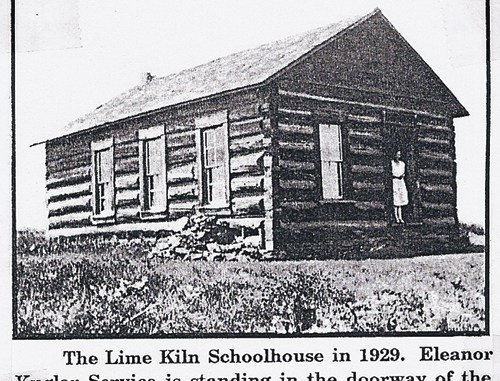 The Lime Kiln Schoolhouse, constructed in 1917, is seen here in 1929 with Eleanor Kugler Service in the doorway. Lime Kiln Schoolhouse is one of 39 school in operation within the county in the past century and most assuredly played a role in the romance of one or a couple school teachers who came into the area to teach.
