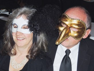 Meeker Pastor Jon Laughlin, right, and Kristina Lubner, left, took the masquerade part of the Black and White Masquerade Ball on Saturday night quite seriously. Most attendees were in blacks, whites and a mix of the two while about 20 of those in attendance at the fund-raiser event for Pioneers Medical Center/Pioneers Healthcare Foundation wore full masks.