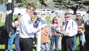David Cole, left, was host of the Memorial Day festivities held in Meeker at the Meeker Town Park and at Highland Cemetery on Monday morning. To his right is Pete Kiser, a 92-year-old veteran who placed a wreath on the monument at the cemetery dedicated to all our service men and women who served in the U.S. Armed Forces.