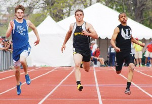 Meeker's TJ Shelton (above) broke the MHS 100-meter dash record, sprinting to a 11.1 finish in the prelims and a second place finish in the finals.