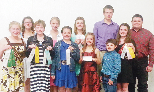The Rio Blanco County 4-H Livestock Judging Team was third place overall junior team at the 68th annual Gunnison County Stockgrowers 4-H Livestock Judging contest. In the back row, from left, are: Kacie Lapp, Jilli Bumgardner, Samantha Lapp (third high individual) and Ty Dunham. In the front row, from left, are: Kenzie Turner (eighth high individual), Macy Collins (ninth high individual), Marryn Shults, Shauna Lapp, Hayden Shults (high individual in the Boogie Division at the annual Gunnison Dance), and Madi Shults (fifth high individual). For the second consecutive year, the junior team won the reserve champion cash prize awarded by the TRA and Gunnison County 4-H Livestock Judging clubs.