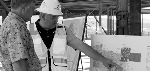 During part of Friday's tour, Ken Harman, right, the CEO of Pioneers Medical Center, reviews the floor plan for the hospital facility with Alan Michalewicz, left, the manager of White River Electric Coop. Hospital and construction personnel helped lead the tour of the facility, slated for and on schedule to open in August 2015.