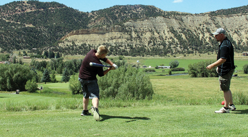 Jake Shelton uses a baseball bat to swing at a golf ball off the No. 1 tee box at the Meeker Golf Course, site of the 10th annual Cowboy Kickoff Classic golf tournament, a fundraiser for the MHS football program. The Cowboys will host the Rye Thunderbolts Saturday in Starbuck Stadium. Kickoff is scheduled for 1 p.m.