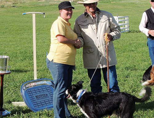 Winner Ron Enzeroth of Dublin, Texas, with his dog, Mick, captured the top money and the trophy at the 2014 Meeker Classic with a spectacular 141 points. See more photos from the trials on Page 6A of this week's Herald Times.