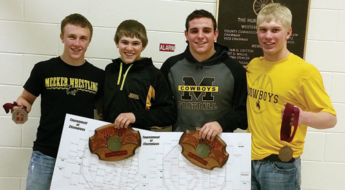 Tristin Pelloni, Sheridan Harvey, T.J. Shelton and Casey Turner wear big smiles holding the hardware they won in the competitive Tournament of Champions, helping their team place eighth. Pelloni finished eighth at 120 as Harvey (113) and Shelton (170) won their brackets. Turner lost in the second round, came back to win six matches and the consolation championship at 152, avenging his loss along the way.