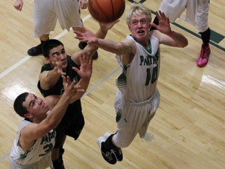 Panthers Colt Allred and Patrick Scoggins go up for a rebound against a Plateau Valley Cowboy during a home game, which the Panthers won 44-21. Rangely will travel to Paonia on Friday to play the Eagles in another league contest.