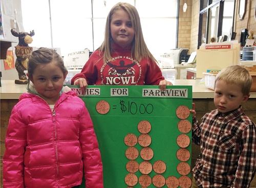 """Parkview Elementary School kindergartener Brielle Lucero, fourth-grader Kenzie Varner and kindergartener Zane Wiley hold up a graph showing each grade's contributions to the """"Pennies for Parkview"""" fundraiser, which will raise money for local breakfast and after-school programs until Spring Break. The schools raised more than $230 in the first week."""
