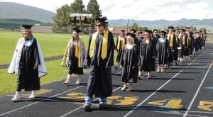 To begin commencement at Meeker High School's Starbuck Stadium on Saturday, members of the senior class marched down the track on the way to their chairs for the graduation ceremony. There were 38 seniors who were graduated on Saturday.