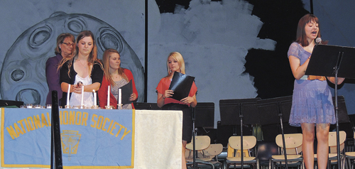 Several Meeker High School students were inducted into the National Honor Society at MHS on May 18 during the 2015 Spring Concert, featuring the bands and choirs at MHS and Barone Middle School. Conducting the National Honor Society induction were, from left to right, MHS language arts instructor and honor society adviser Kathleen Kelley, NHS Chapter President Brittany Smith, chapter Vice President Reagan Pearce, Paige Dowker, an NHS representative to the MHS Student Council, and Dominique Devore, also an NHS representative to the MHS Student Council. Kelley was assisted in the ceremony by fellow language arts teacher Cheri Robinson.
