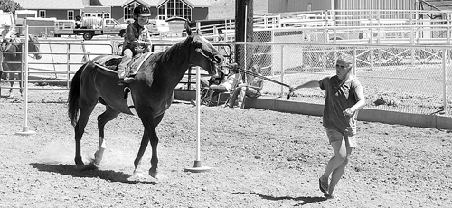 Molly Theos, right, leads Lukas Coryell around the poles in one part of the 4-H PeeWee Horsemanship Class. For the youngest riders, they are allowed to be led around the obstacle course; not so for the older riders. The class was held Saturday on the far north track at the Rio Blanco County Fairgrounds in Meeker as one of the opening events for the fair.