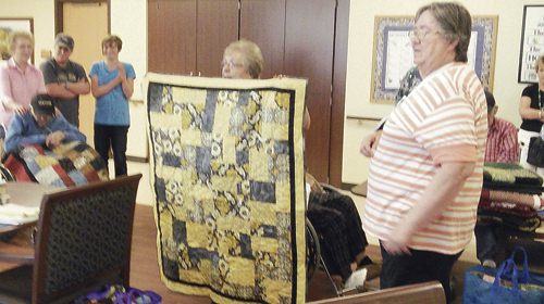 At left is one of 26 quilts made by the Rio Blanco Stitchers and presented to residents of the Walbridge Wing at Pioneers Medical Center. The Stitchers presented the quilts to the patients on July 14, and they also make quilts for those in hospice care.