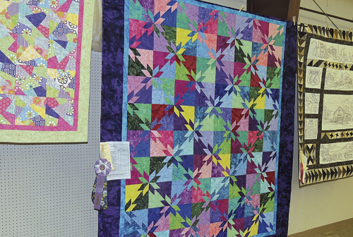 Numerous quilts of all sizes, shapes and designs were on display in the exhibit hall at the Rio Blanco County Fair, demonstrating the talents of the quilters throughout Rio Blanco County. The center quilt was chosen for second place and Reserve Champion honors. The quilt was completed by Lori Farris.