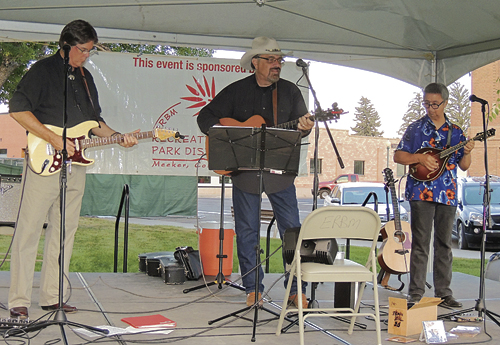 Jon Chandler, center, a long-time Front Range purveyor of country, Western, folk and bluegrass music, brought his band to Meeker on Friday for a concert on the courthouse lawn under the setting sun. The combined sounds of the electric guitar, acoustical guitar and the mandolin made for a highly entertaining concert of mixed country-style music. Sponsored by the WRBM Recreation and Park District as part of its 10th annual Summer Entertainment Series, there was a group of about 60 people in attendance.