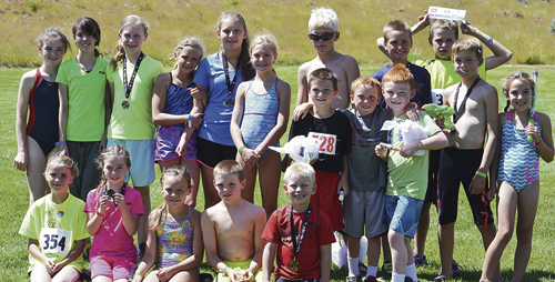 The 2015 ERBM Recreation and Park District Road Rash 'n Splash Kids Triathlon took place Aug. 4 with more than 20 kids participating, including several from Craig, where they swam, biked and ran, competing in four different age division. Front row, from left: Madison Mendenhall, Addison Knowles, Alexis Neton (Craig), Hudson Jones (Craig), Patrick Neton (Craig), Reed Goedert, Finley Deming and Montey Franklin. Back row, from left: Hadley Franklin, Savannah Mendenhall, Hailey Knowles, Megan Neton (Craig), Alexa Neton (Craig), Colby Clatterbaugh, Elijah Deming, Zagar Brown, Brendan Clatterbaugh and Reese Clatterbaugh. Not pictured are Rayna VonRoenn, Carter Strate and Molly Neton.