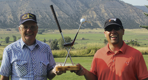 Irv Griffin, left, had a good weekend of golf at the Meeker Men's Club Championship as he captured first place in the second flight, but he also turned in the first sub-par score of his life. J.C. Watt, right, also had another good tournament over the two days of the tournament, having won the championship flight for the third straight year.