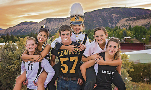 """Meeker High School Homecoming activity representatives pile on for a big """"Go-Cowboys"""" Week, which begins Monday. From left to right are: Maggie Phelan in volleyball; Delenn Mobley for cheerleading; Chase Rule for football; Madeline Amack for the marching band; Sierra Williams in softball; and Julia Eskelson for cross-country."""