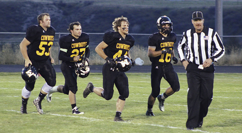 Meeker seniors Kash Atwood, Dillon Frantz, Devon Pontine and T.J. Shelton were the team captains for the 2015 homecoming football game against the Lake County Panthers. The senior captains led the Cowboys to a 45-14 victory in the first league contest of the season. The Cowboys will play the defending state champion Eagles in Paonia on Friday, with the kickoff scheduled for 7 p.m.