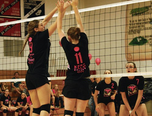 Meeker volleyball players Reese Pertile and Maggie Phelan go up for a block against the Eagles in Paonia. The lady Cowboys lost in three games to the Eagles and then to Cedaredge last Saturday. Meeker will get another shot at Cedaredge, as the Bruins come to town Friday.