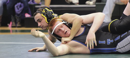 Meeker Cowboy senior Dillon Frantz uses a turk to score back points against a Coal Ridge opponent during the Vern Rose Memorial tournament in Rangely on Friday. Frantz pinned four of his five opponents and won the 195-pound bracket. Frantz and eight other Cowboys won individual titles, easily giving Meeker the team title. Meeker will wrestle in the Screaming Eagle tournament in Paonia on Saturday, which will feature five of the top six rated teams in 2A.