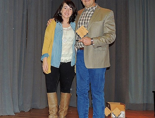 As well as feeding at least 200 people at the Rangely Chamber of Commerce's Crab Crack on Feb. 6 on the Colorado Northwestern Community College campus, the chamber also handed out their business awards of the year. Above, Rangely Chamber Executive Director Kristin Steele, left, presented Jeff Rector of DUCO Inc., with the Industry of the Year Award.