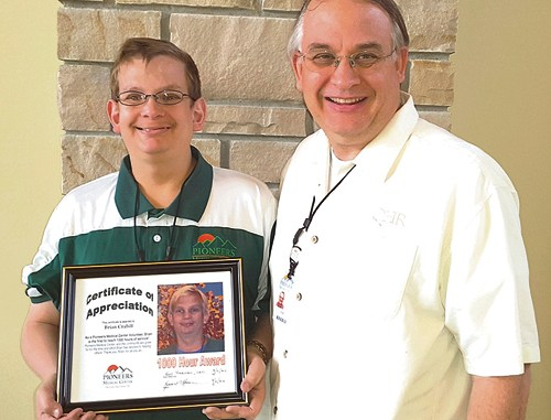 "Pioneers Medical Center CEO Ken Harmon presented Brian Crabill of Meeker with a plaque thanking him for more than 1,000 hours of volunteer work at the hospital. Crabill started volunteering with Pioneers Medical Center in June 2015 and in March of 2016 he reached more than 1,000 hours of volunteer time. ""Brian is a dedicated and caring volunteer,"" said Danette Coulter, one of the directors of volunteers at PMC. ""Brian is our primary greeter. He helps direct patients and visitors to their appropriate destination. We love having Brian at PMC."""