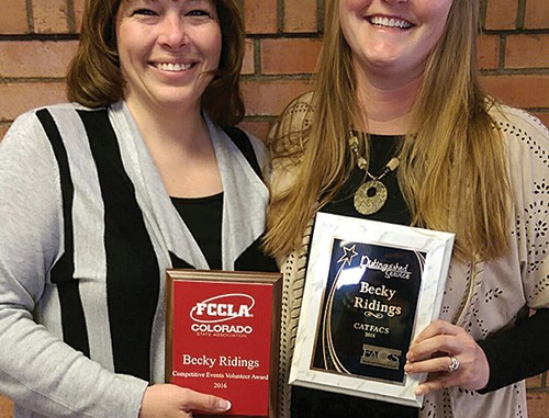 Becky Ridings on the left and Brenda Mullins on the right with the two awards Ridings has recently won due to her involvement with the Family and Consumer Science program at the high school. Mullins presented Ridings with these awards at last week's school board meeting.