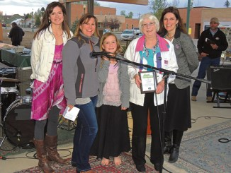 Two major awards were presented Friday night at the annual Meeker Chamber of Commerce Membership and Awards Dinner, held outside this year near the gazebo between the old courthouse and new Justice Center in downtown Meeker. From left to right, Meeker Chamber Executive Director Stephanie Kobald, Chamber Board Member Ann Marie Scritchfield and her daughter, Eva, present Diane Dunham with the Citizen of the Year Award for all of her volunteer work for several organizations in Meeker. At far right is Meeker Board President Diana Jones.