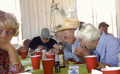 Among the many folks enjoying a rib dinner courtesy of the Rio Blanco County Cattlewomen on Friday evening at the Upper Colorado Environmental Plant Center on County Road 4 were, from left, Connie Hughes, Ty Dunham, Gary Dunham, Bill Dunham and Diane Dunham. The purpose of the gathering was a landowner appreciation barbecue put on by the Douglas Creek and White River conservation districts and a tour of the plant center.