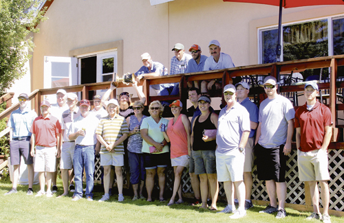 """Meeker Men's Club President Larin Crase, surrounded by most of his teammates, raises the """"Cup"""" over his head in victory, after they defeated Rangely golfers 34-22 in the 12th annual Rio Blanco County Cup. The """"Cup"""" will now be displayed in Meeker's clubhouse for the next year."""